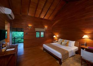 A bed or beds in a room at Cinnamon Wild Yala