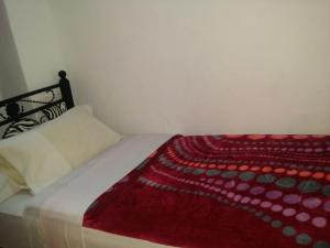 A bed or beds in a room at Riad Espagne