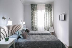 Un ou plusieurs lits dans un hébergement de l'établissement Blanc Guest House