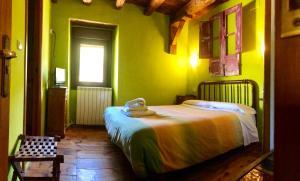 Cama o camas de una habitación en Casa Rural Araceli