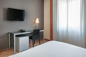 A television and/or entertainment center at AC Hotel Los Vascos