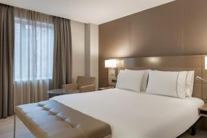 A bed or beds in a room at AC Hotel Los Vascos