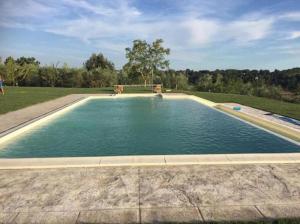 Het zwembad bij of vlak bij Agriturismo La Collina