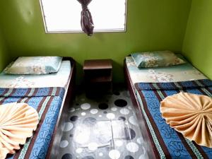 A bed or beds in a room at Osman's Homestay