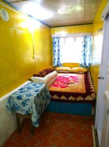 A bed or beds in a room at Youth Hostel Sirikhola