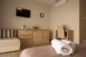 A bed or beds in a room at Centar lux 2