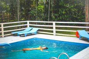 The swimming pool at or near Caboclos House Eco-Lodge
