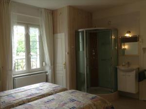Un ou plusieurs lits dans un hébergement de l'établissement Chambres d'hotes Villa Nantrisé