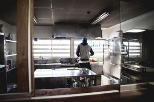A kitchen or kitchenette at Hakuba Cortina Backpackers