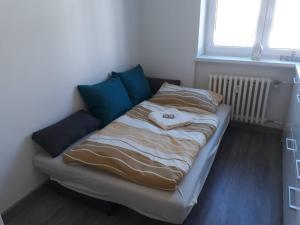 Posteľ alebo postele v izbe v ubytovaní Apartman Dominik