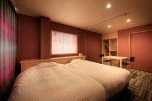 A bed or beds in a room at Marukyoo