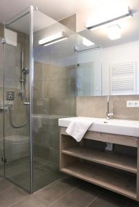 Ein Badezimmer in der Unterkunft Tauernsuites Mitterwirt by Alps Residence