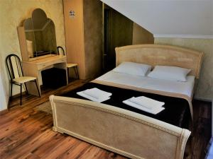 Кровать или кровати в номере Гостиница Элис