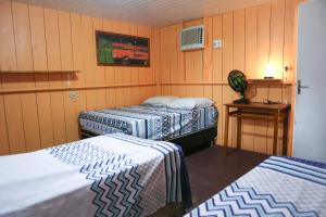 A bed or beds in a room at Caboclos House Eco-Lodge