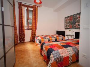 Letto o letti in una camera di Ca Rossa - Venezia