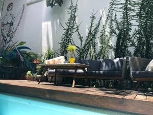 The swimming pool at or near Cosmopolitano Hotel Boutique