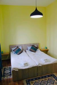 Letto o letti in una camera di Nana's Home