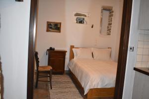 Ένα ή περισσότερα κρεβάτια σε δωμάτιο στο Sabouko Guest House