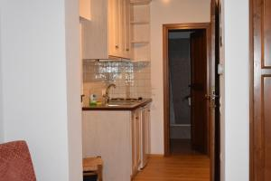 Η κουζίνα ή μικρή κουζίνα στο Sabouko Guest House
