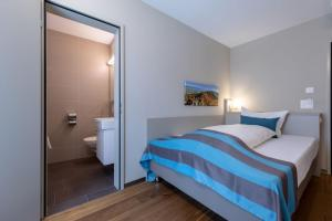 A bed or beds in a room at Trip Inn Zurich Hotel