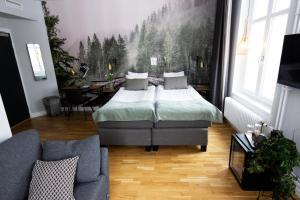 Säng eller sängar i ett rum på Livin Station Hotel