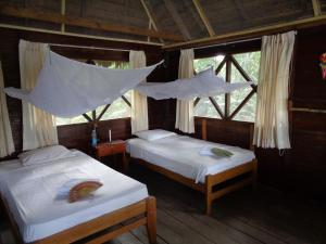 A bed or beds in a room at Tambopata River