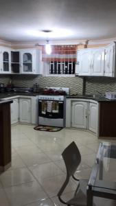 A kitchen or kitchenette at LA CASA guest house and bar