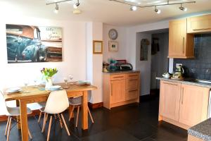A kitchen or kitchenette at Petrock Holiday Cottages
