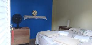 A bed or beds in a room at Chalé iglu joto