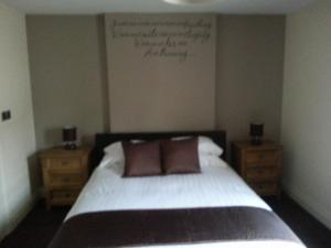 A bed or beds in a room at The Court House Inn