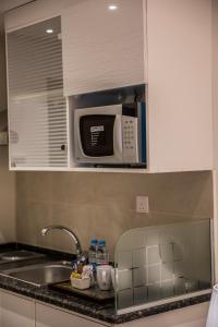 A kitchen or kitchenette at Naylover Hotel Suites