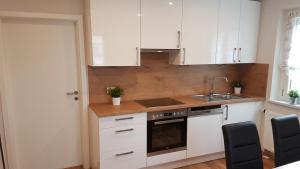Küche/Küchenzeile in der Unterkunft Gästehaus Neumarkt