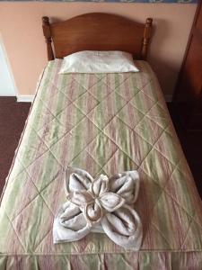 Un ou plusieurs lits dans un hébergement de l'établissement Posada Don Giorgio