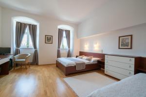 Posteľ alebo postele v izbe v ubytovaní Kúria Beckov - Penzión
