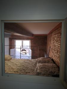 Un ou plusieurs lits dans un hébergement de l'établissement Riverside Toulouse (Renaissance)