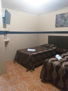 Cama o camas de una habitación en Hacienda Cañada Rica 1