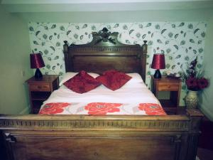 A bed or beds in a room at The Bank House Hotel