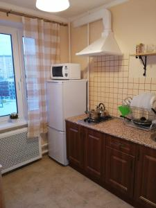 A kitchen or kitchenette at Vnukovo Sokol-Apart 2