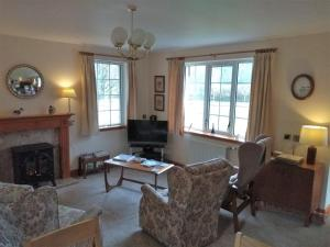 A seating area at Bridge of Bennie Cottage