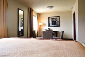 A bed or beds in a room at Super 8 by Wyndham Fox Creek
