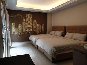 A bed or beds in a room at Danka@Taman Golf Residence 4 BR