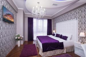 Кровать или кровати в номере Бутик-отель Де Пари