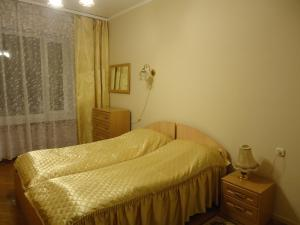 """A bed or beds in a room at Дом отдыха """"Клязьма"""""""