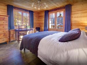 A bed or beds in a room at Fleur des Neiges Grand Bornand - OVO Network
