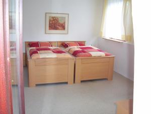 Ein Bett oder Betten in einem Zimmer der Unterkunft Ferienwohnung-Osten
