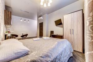 Кровать или кровати в номере Apartment on Malaya Moskovskaya