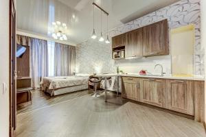 Кухня или мини-кухня в Apartment on Malaya Moskovskaya