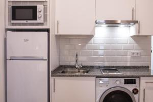 A kitchen or kitchenette at Gran Central Suites