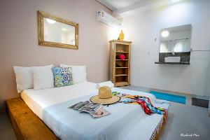 Cama ou camas em um quarto em Jardim Secreto