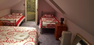 A bed or beds in a room at Guest House Ellipse